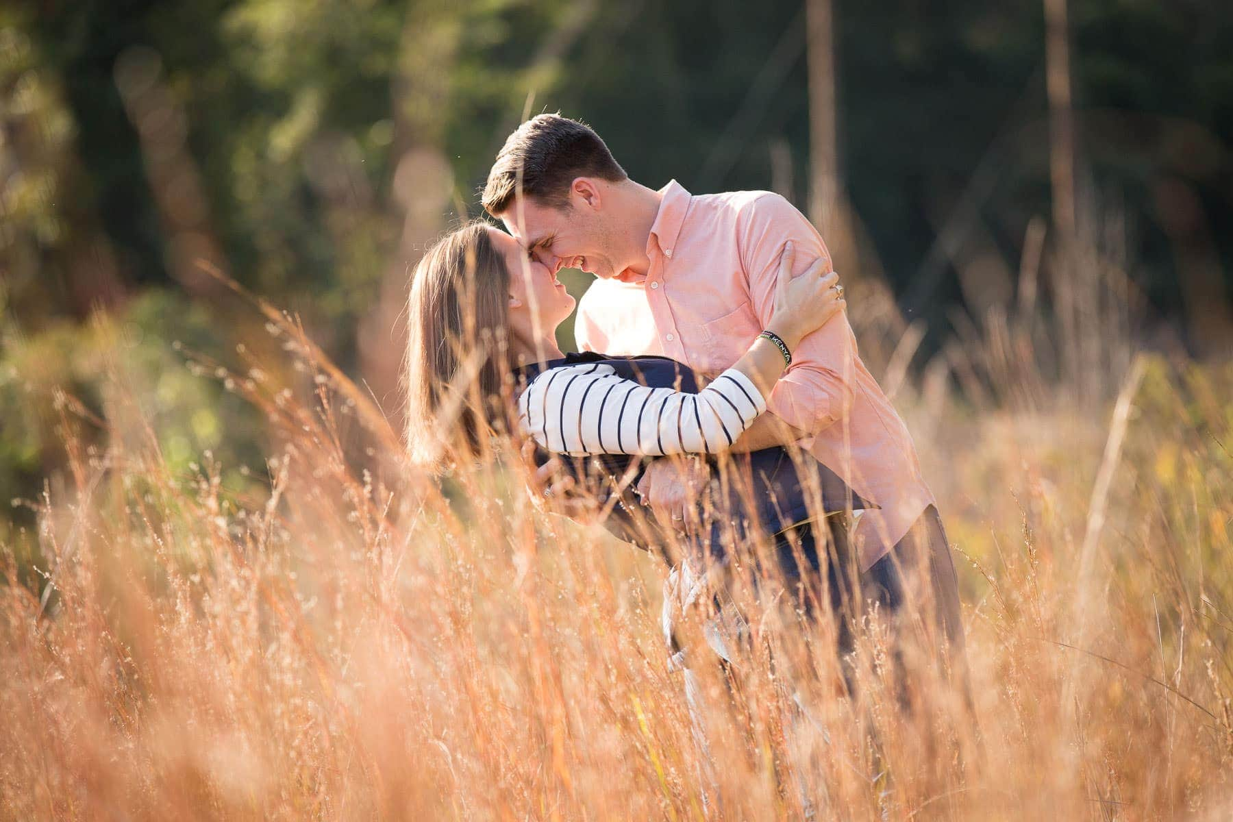 husband dips wife behind tall grass sweetheart session columbia, sc