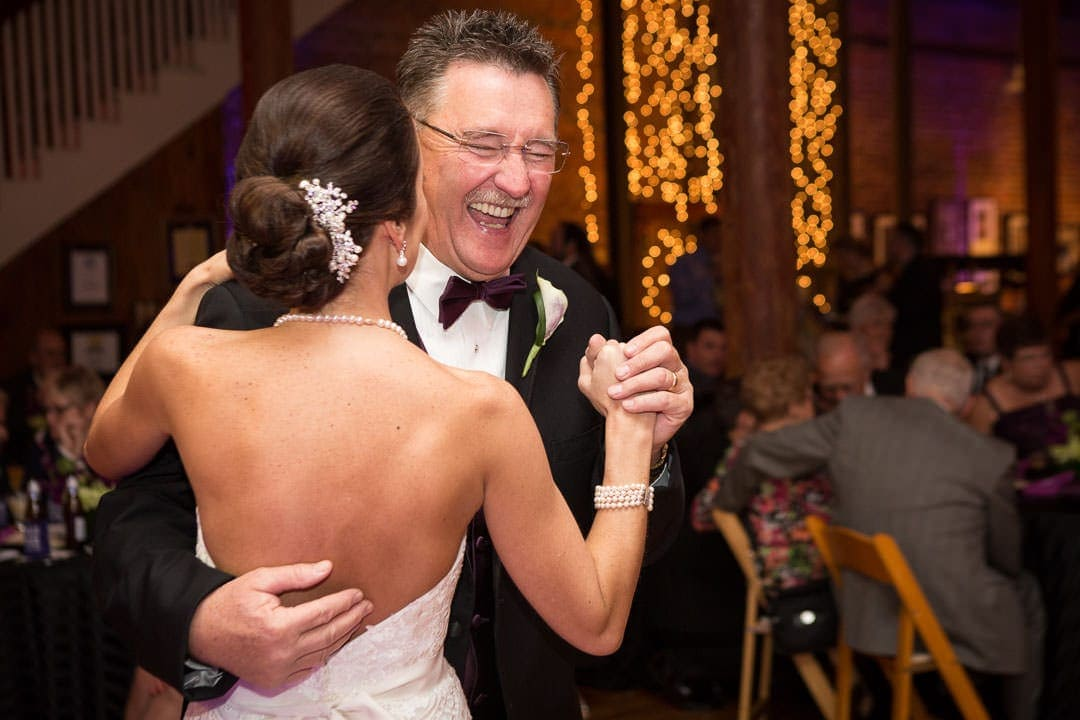 bride dances with her other father