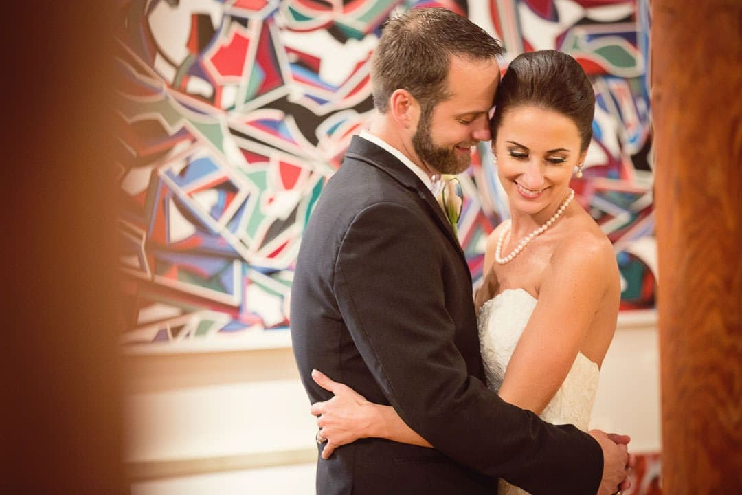 bride and groom in art gallery reception portrait