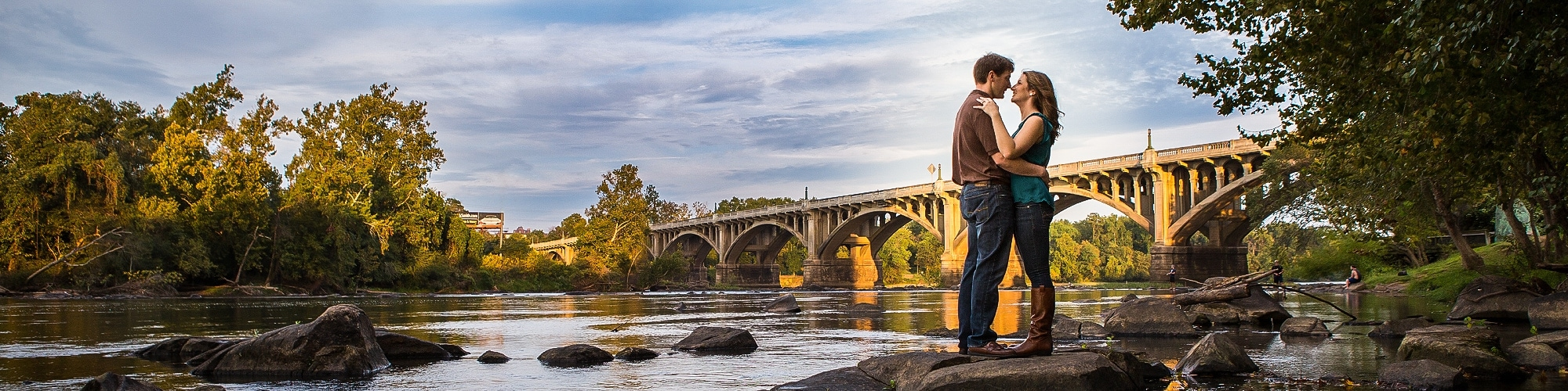 Engagement session at the Congaree River in front of the Gervais Street Bridge